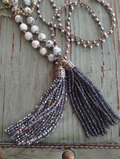 A crocheted chain of sparkly faceted semi precious stones holds an equally sparkly long glass tassel. Iridescent blue undertones in the glass so it looks super with denim. Dress it up or down! Great holiday party necklace :) This one also looks even better layered with shorter necklaces...