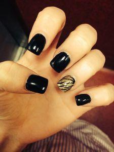 Black and Gold Cute Acrylic Nail Design. See more at http://www.naildesignsforyou.com/30-cute-acrylic-nail-designs/ | http://www.naildesignsforyou.com #cutenails #cuteacrylicnails #acrylicnails #cutenaildesigns #cutenailart