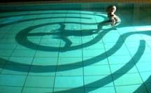 """One of the specialties  of Labyrinth Maker Jim Buchanan   of Scotland are his amazing labyrinths   out of shadow and projected light. Jim used this test projection   - in a small therapy swimming pool.  Its for public use as of April, 2005,  in Utrecht, Holland.   """"A real water labyrinth!"""""""
