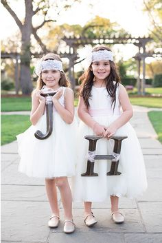 flower girls with letter instead of petals- captured by Michele Shore Photography http://www.weddingchicks.com/vendor-guide/michele-shore-photography-llc/