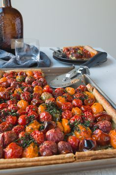 Puff Pastry Tomato Tart with Macadamia Nut Pesto - Roasted heirloom tomatoes, creamy burrata cheese & fresh herbs fill this flaky puff pastry tart, making it a rustically elegant addition to any brunch or dinner.  Click for recipe.