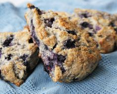 Whole Wheat, Olive Oil & Berry Scones  1 cup all-purpose flour  1 cup whole wheat flour  1 Tbsp. sugar (optional)  1 Tbsp. baking powder  1/4 tsp. baking soda  1/4 tsp. salt  1/4 cup butter, chilled and cut into pieces  1/4 cup mild (not extra-virgin) olive or canola oil  3/4 cup milk or buttermilk  1 cup fresh or frozen berries (don't thaw them)  Preheat oven to 400°F.  Put the flours, sugar, baking powder, baking soda and salt in the bowl of a food processor or into a medium mixing bowl…