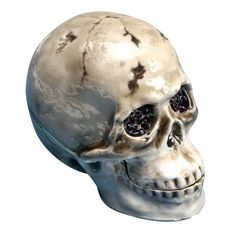 """What treasures can one skull contain? That's up to you. Enameled, bejeweled box with pewter and crystal accents. 2½"""" x 3"""". This product has a Lead Time of 7 days."""