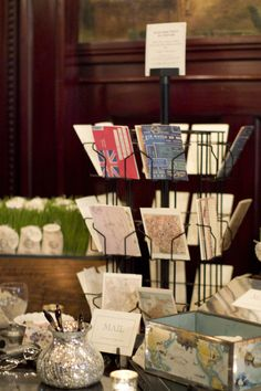 A great idea to use postcards for the guest book. I love displaying them in the post card holder like stores.  Storybook Wedding Consulting