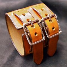 This 2.5 double strap bracelet in vegetable tannned leather is hand cut and hand dyed Saddle tan! The edges are worked smooth and sealed and the finish is waxed to bring out the beauty of the natural leather! 2 nickel centerbar buckles provide closure. Handmade by Me for YOU in