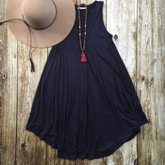 PRE-ORDER'S for the Blair Dress in NAVY and BURGUNDY will ship out Tuesday June 21st. This t-shirt dress can be dressed up or down. No matter how you wear it yo