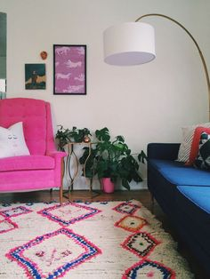 that pink chair . . . midcentury design + moroccan carpet from the boucherouite, azilal or berber tribe