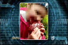 ¡IMAGENES POLEMICAS! En Nueva Zelanda un padre pública con bastante orgullo foto de su hija con el corazón de un venado acabado de cazar