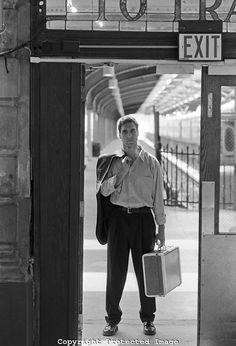 Google Image Result for http://cdn.c.photoshelter.com/img-get/I00000ligWSmJYE0/s/860/860/man-standing-at-a-train-station-in-a-doorway.jpg