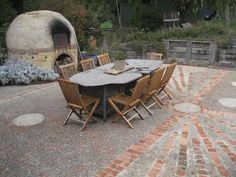 Stone table and mud brick oven.