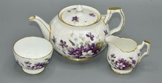 For Sale we have a delicate and pretty Aynsley Teapot Milk and Sugar in the Violette design. The teapot is in the pretty crocus shape. Sweet Violets, Hand Painted Plates, Side Plates, Milk Jug, Tea Sets, Sugar Bowl, Bone China, Teapot, Blue Gold