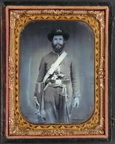 Unidentified cavalry soldier in Union uniform with Sharps carbine rifle, Colt revolver, and cavalry saber -- Liljenquist Family Collection of Civil War Photographs; Ambrotype/Tintype photograph filing series; Library of Congress