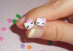 Teeny Tiny Hello Kitty Post Earrings. $4.50, via Etsy.