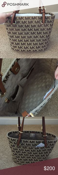 Brand New Michael Kors Purse Brand New Michael Kors Purse. Amazing condition. Roomy interior with pockets. Small, hardly noticeable pocket on side of the purse. Tan ish straps. Purse is light brown with letters in darker brown. Michael Kors Bags
