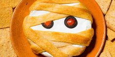 Thanks to puff pastry, your basic baked brie becomes a totally spooky Halloween appetizer.