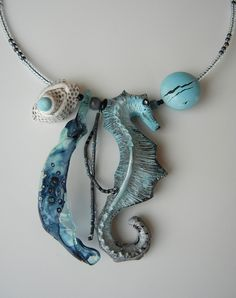 Tranquil Waters - Weightlessly surrounded by bubbling clear water - back to the origins of life.  (Polymer clay, plastic, Mijuki beads - no molds used...)
