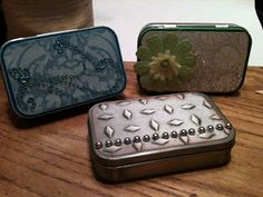 I love that she used embossed cardstock (run through a Xyron) to cover her tins.