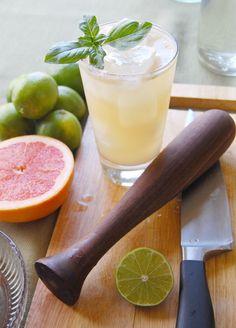 The Plantation: 1.5 oz. gin, 0.5 oz. Cointreau or other orange liqueur, 0.5 oz. simple syrup, 1.5 oz. fresh grapefruit juice, 1/2 lime quartered, 4-5 leaves fresh basil,  and club soda