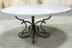 zinc dining table, round top  made by  the artisans at www.ecustomfinishes.com