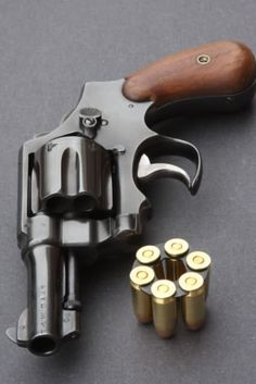 """Smith & Wesson Model 1917 S&W D. """"Fitz Special"""" (Barrel Shortened to Modified Front Sight & Front of Trigger Guard Removed for Quick Draw) 2 words. Survival Weapons, Weapons Guns, Guns And Ammo, Custom Revolver, Revolver Pistol, Smith And Wesson Revolvers, Smith N Wesson, Quick Draw, Fire Powers"""