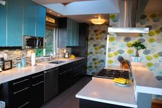beautiful! not a blue person, but i like this!... Mid Century Modern Kitchen — love that wallpaper!