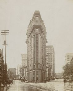 Looking south at the intersection of Peachtree and Broad Streets facing the English American Building, c. 1907 Atlanta GA. Popularly referred to as the Flatiron Building, this structure was built in 1897 and designed by architect Bradford Gilbert