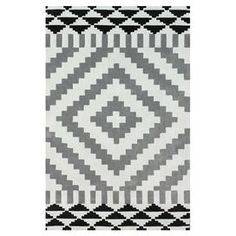 Hand-tufted rug with a geometric diamond motif.  Product: RugConstruction Material: 100% PolyesterColor: Light greyFeatures: Hand-tuftedNote: Please be aware that actual colors may vary from those shown on your screen. Accent rugs may also not show the entire pattern that the corresponding area rugs have.Cleaning and Care: Spot treat with a mild detergent and water. Professional cleaning is recommended if necessary.