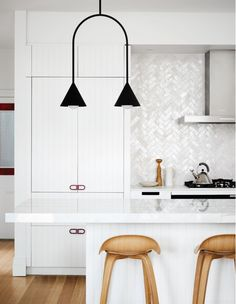 Pendant light: Conehome Single Arch by LAAL. Tiles: Moroccan Bijmat from Earp Bros and installed by Baz of National Tilers. Wall and Cabinet: Dulux Natural White. Benchtops: cooktop Zenith by Dekton from Cosentino. Kitchen fabricated by Plane Architectural Joinery. Photo – Tess Kelly.