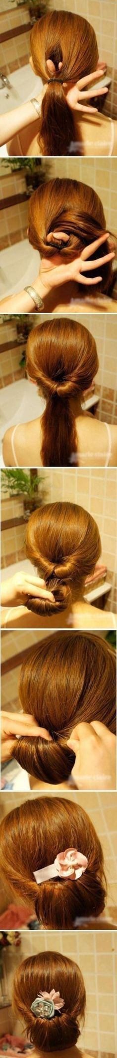 Simple low bun with flower accessory