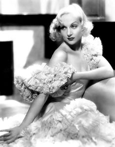 """sparklejamesysparkle: """"Carole Lombard in a publicity portrait for the pre-code Columbia Pictures drama Brief Moment, 1933. Miss Lombard's gowns in the film were designed by Robert Kalloch. """""""