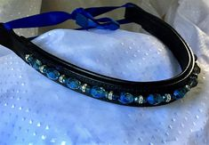 17 inch black padded leather browband with glistening blue crystal beads. Ride with style! FREE FAST shipping in the USA!
