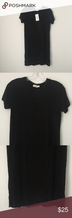 """GOTH PUNK BLACK SOFT STRETCH TEE SHIRT MINI DRESS! Awesome Basic Solid Dark Black SUPER SOFT Stretch Short Sleeve High Scoop Crew Neck Crewneck Mini Bodycon Tee Shirt Dress Goth Gothic Punk Emo Scene Grunge Witchy.  Brand new. Never used. NO flaws. Slightly relaxed fit. Not tight but not too loose.  Sorry for shitty lighting! Color is a true, pure, dark black in person.  Tagged as women's Small.  •Chest- 17.5"""" across •Length (shoulder to bottom)- 32"""" long  •NO holds, returns or refunds. •The…"""
