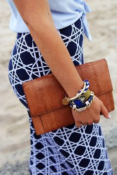 love everything. navy maxi. leather clutch. bracelets.