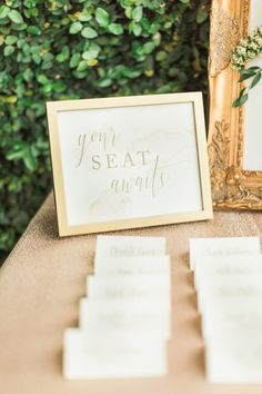 Your seat awaits wedding sign