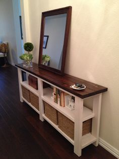 Thin entryway table with mirror & storage - Love it! You could also just hang the mirror on the wall, and have more table space. This would be a great place to put extra games/books/movies too.. Krissy :)