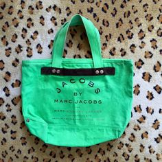 [MARC JACOBS] Green Canvas Tote Super cute vibrant green canvas tote by Marc Jacobs. Re-poshing. Never used by me - it is in the same condition it was sent to me in. IT HAS MARKS OF DIRT on the inside and outside (price has been adjusted accordingly) but it is in good used condition overall and should definitely be put to use. Happy to provide more pictures if needed! Marc by Marc Jacobs Bags Totes