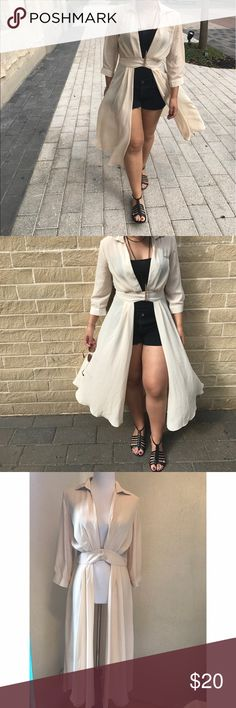 Flowy long dress shirt Flowy long dress shirt, can be worn as a dress/jacket or even shirt. Possibilities are endless, great with shorts or even a cute pair of jeans. Tops Button Down Shirts