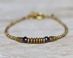 Brass beaded bracelet brass discs and black spinel beaded by Filoe, $22.00