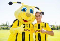 Dortmund's Emre Mor poses during with mascot Emma at the team presentation of Borussia Dortmund on August 17 2016 in Dortmund Germany