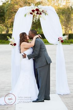 Floral accents on outdoor arch (Flowers by Lee Forrest Design, photo by: Orlando Wedding Pix)