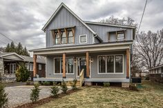 Urban Farmhouse Exterior. See entire project on  Houzz: https://www.houzz.com/projects/234559/urban-farmhouse  #blue #exposedwood #frontporch #eastnashville www.marcelleguilbeau.com