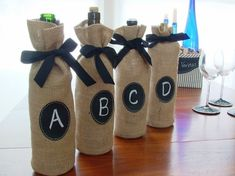 Cute way to give wine:  Burlap Wine Bottle Bags with Message Labels  by SouthHouseBoutique, $20.00
