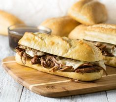 These Easy Crock Pot French Dip Sandwiches are as simple as adding the ingredients to your slow cooker and letting it infuse your house with the intoxicating aroma of beef simmering in a richly seasoned Reuben Sandwich, Sandwich Recipes, Sandwich Ideas, Crock Pot Dips, Crock Pot Cooking, Alton Brown, Sin Gluten, Slow Cooker Recipes, Crockpot Recipes