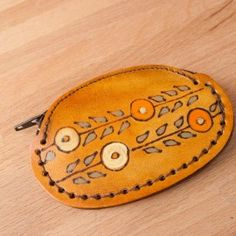 Mid-century modern leather coin purse with a stylized flower and vine pattern.  Handmade by Moxie & Oliver