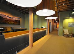 Love front desk w/lighting below. Great use of different architectural shapes (circular lights, straight beams), very interesting.