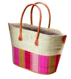 Smaller version of our large beach baskets.  Cream top with hot pink stripes, drawstring closing and leather reinforcements and handles.