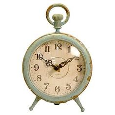 Antique-inspired table clock with a weathered finish.Product: Table clockConstruction Material: MetalColor: TurquoiseAccommodates: AA Batteries - not included Dimensions: 6.75 H x 4.75 W