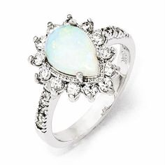 Cheryl M Sterling Silver Opal Pear Ring PURITY RING   this ring would be amazing with a diamond in the middle for an engagement ring :) LOVE LOVE LOVE