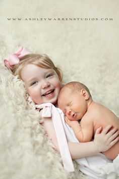 Sibling pose- for my big girl and little one! I love this but i don't know if i could get bells to smile like that!