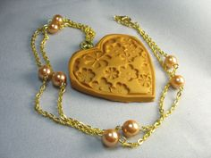 Heart necklace  gold polymer clay stamped by lennonsleadinglady, $18.00